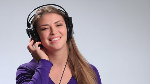Beautiful woman with headset listening music Footage