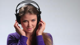 Sexy young woman listening to music playfully Footage