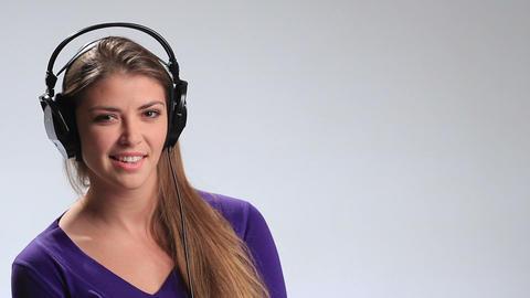 Attractive girl listening to music headphones Footage