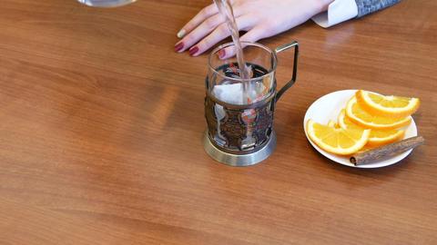Green tea. Girl pouring tea into a glass cup 영상물