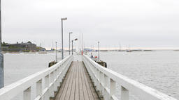 Empty wooden walkway to small landing pier, cool autumn look Footage