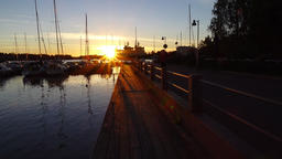 Sunrise at marine pier, woman jogging at harbour shore at early morning Footage
