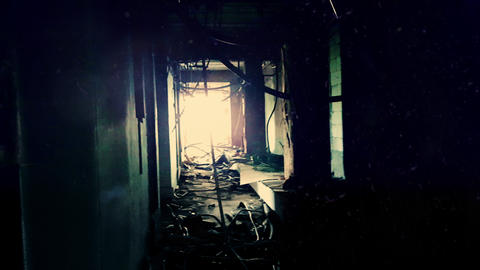 Gloomy corridor with damaged wiring hanging on walls and sticking out floor in a Footage