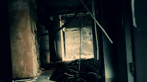 Handheld camera brokenly moves through hall of abandoned factory. Industrial bui Footage