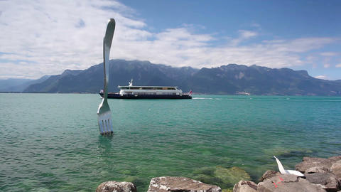 Giant steel fork in water of Geneva lake, Vevey, Switzerland Footage