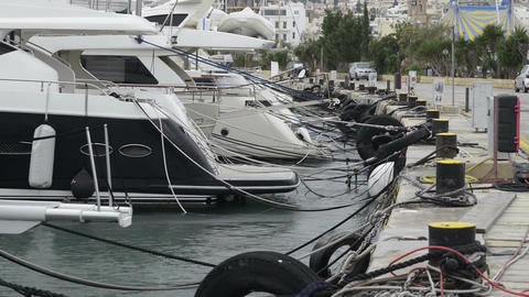 Yachts moored at Manoel Island Marina in Malta. Sail boats in a row on docks at  Footage