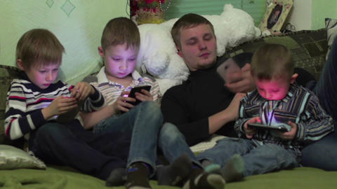 father of many children, and his sons with smartphones Footage