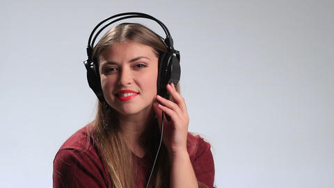 Sexy woman wearing headphones and listening music Footage