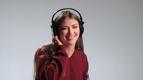 Young woman relaxing with music in heaphones Footage