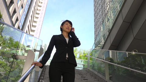 Office Buildings And Happy Asian Businesswoman Walking Down The Stairs Footage