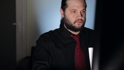 Businessman is working late at night at his computer Footage