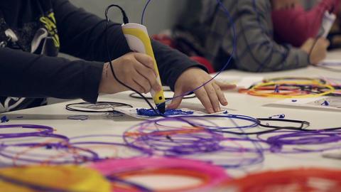 Children paint using 3D pen Footage
