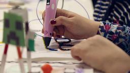 Woman paints using 3D pen Footage