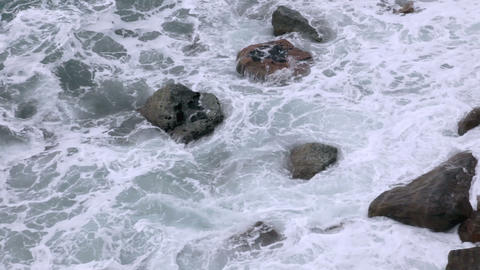 Rocks and surf Stock Video Footage