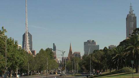 Downtown Melbourne street with St. Paul's Cathedral and Victorian Arts Centre Spire Footage