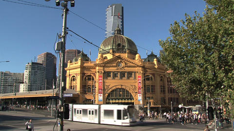 Trams at a busy street around Flinders station Footage