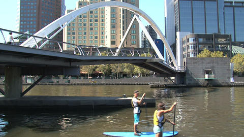 Stand up peddle at the yarra river Stock Video Footage