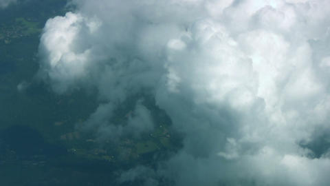 Land below the clouds Stock Video Footage