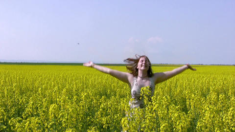 Girl and canola field Stock Video Footage