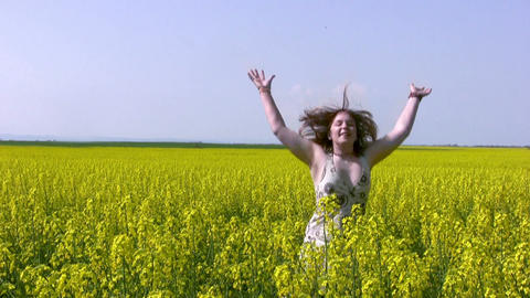 Girl and canola field Footage