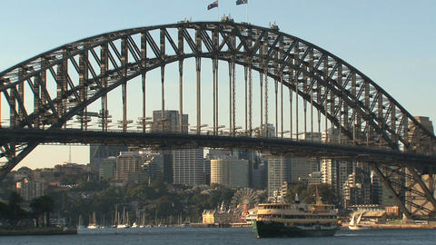 Harbour bridge with ferry arriving Stock Video Footage