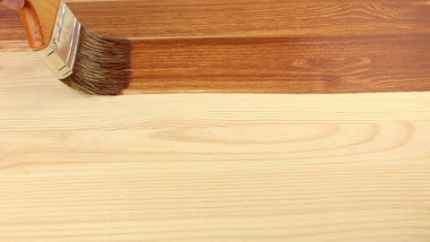 Varnishing of the wooden board Footage