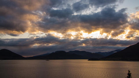 Cloudy mountain and ocean sunset Stock Video Footage