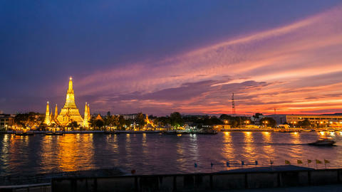 1080 - WAT ARUN TEMPLE AT SUNSET - Bangkok Timelap Stock Video Footage