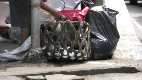 Homeless Woman Going Through Garbage Stock Video Footage
