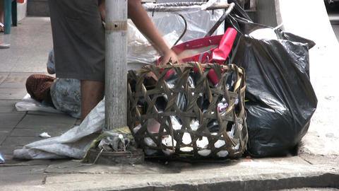 Homeless Woman Going Through Garbage stock footage