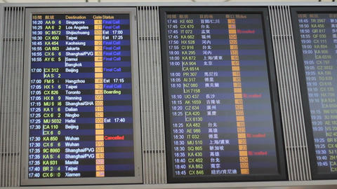 Man Checks Flight Departure Board At Airport Stock Video Footage