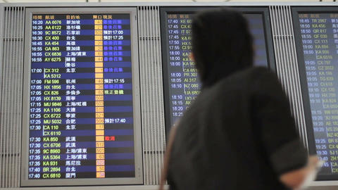 Man   Checks   Flight   Departure   Board   At   Airport stock footage