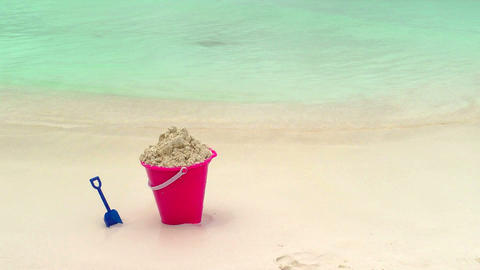 Childs Bucket and Shovel Sitting on Tropical Beach Stock Video Footage