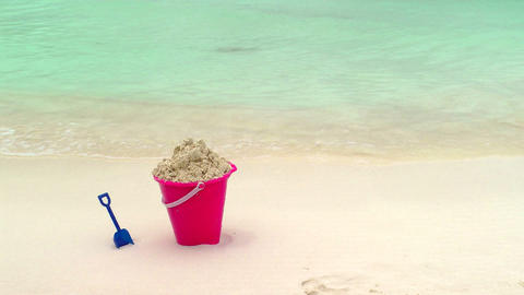 Childs Bucket and Shovel Sitting on Tropical Beach Footage