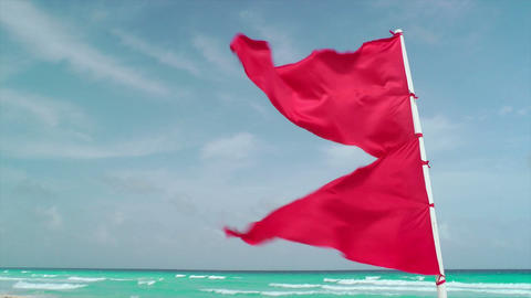Red Flag Waving on Tropical Beach Footage