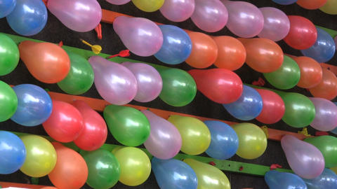 Popping Balloons At A Carnival Stock Video Footage