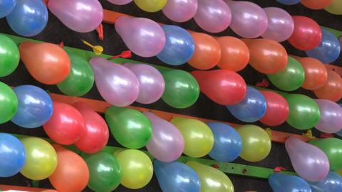 Popping Balloons At A Carnival stock footage