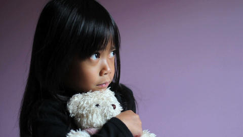 Sad Little Girl Hugging Teddy Bear Footage