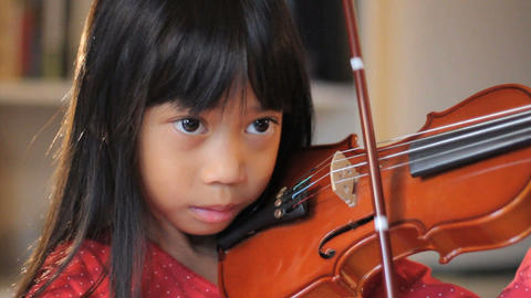 Six Year Old Asian Girl Practices Her Violin Close Up Stock Video Footage