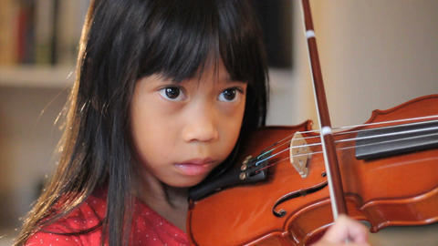 Six   Year   Old   Asian   Girl   Practices   Her   Violin   Close   Up stock footage