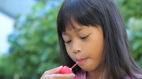 Smiling Asian Girl Enjoys A Popsicle Close Up Stock Video Footage