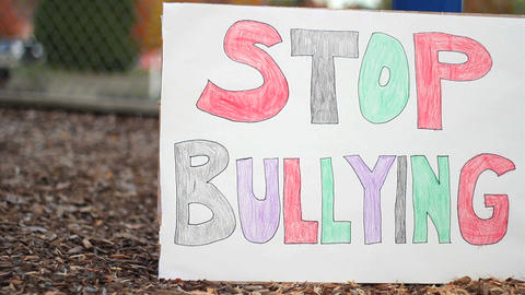 Stop Bullying Sign On School Playground Stock Video Footage