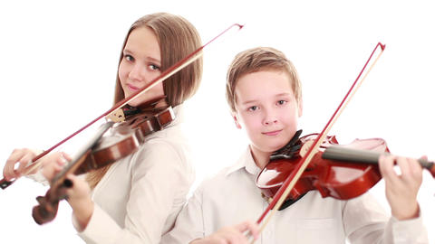 Two teenager playing the violin Footage