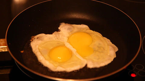 Eggs fried in a pan Stock Video Footage