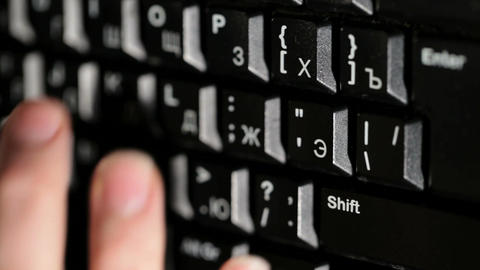 Woman is typing on the keyboard Stock Video Footage