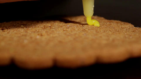 Drawing on ginger cookies. Macro shot Stock Video Footage