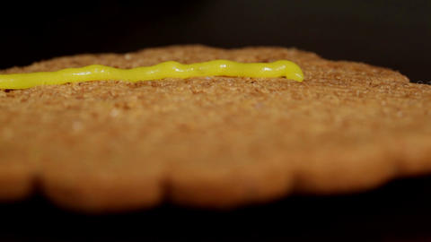 Drawing on ginger cookies. Macro shot Footage