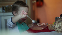 Two year old boy eats fish soup from the plate. Clip three Stock Video Footage