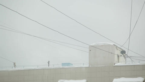 Wires and house roof with snow Footage