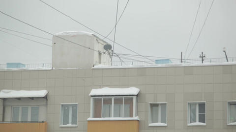 Wires and house roof with snow Stock Video Footage